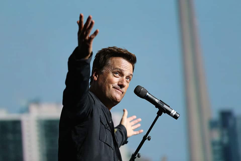 Michael W. Smith with open hands