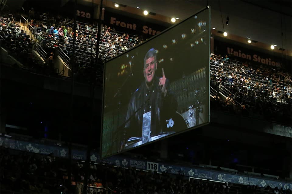 Franklin Graham speaking to people, jammed up into the rafters. Nearly 16,000 people packed the Air Canada Centre on Saturday.