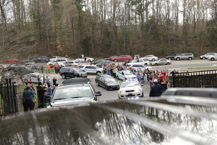 People waved and some captured the moment with their phones as the motorcade pulled off Billy Graham Parkway and into the Billy Graham Evangelistic Association headquarters in Charlotte, North Carolina.
