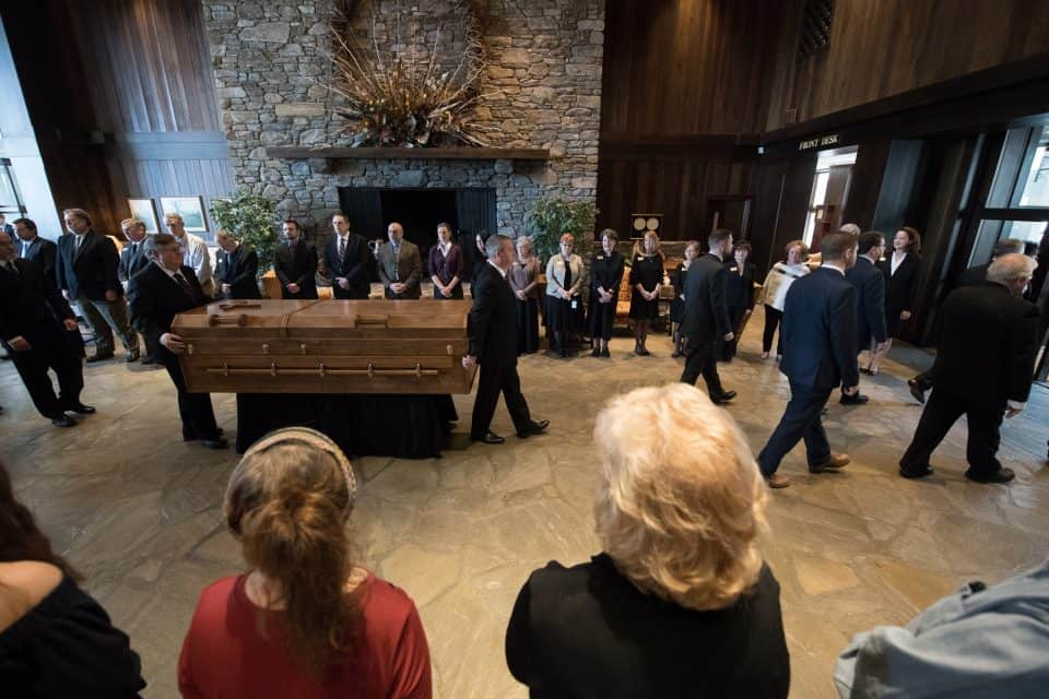 A private ceremony was held at the Billy Graham Training Center at The Cove in Asheville, North Carolina, on Saturday morning. Then, Billy Graham's casket was carried outside to the waiting hearse.
