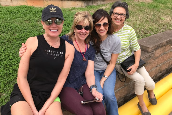 From left to right: Genia Rogers, Kat Wassung, Claudia Harthan and Azu Jorgensen. The four women gathered on the outskirts of uptown Charlotte to watch the motorcade pass by.