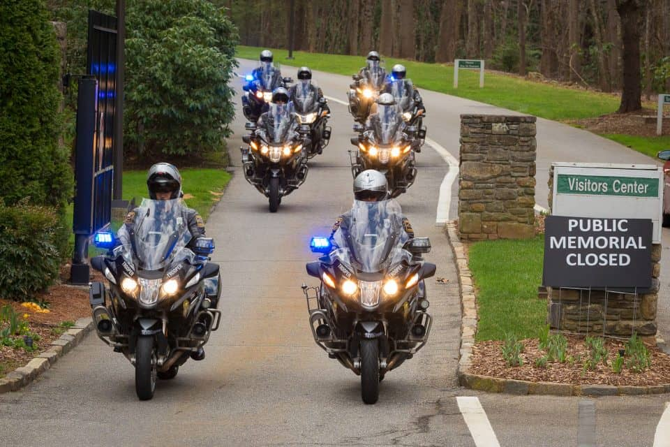 A group of eight North Carolina Highway Patrol officers on motorcycles led the motorcade.