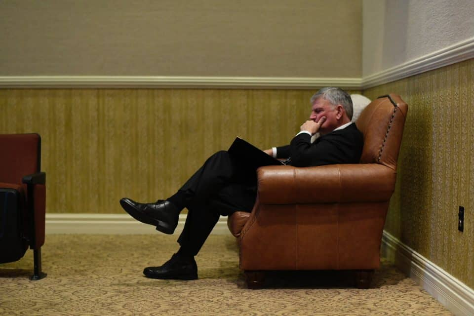 "Franklin Graham pauses for a quiet moment on Friday. At the conclusion of his funeral remarks, he said, ""Daddy, I won't see you on this earth again but I will see you again. I'll see you maybe soon, but not yet. To God be the glory."""