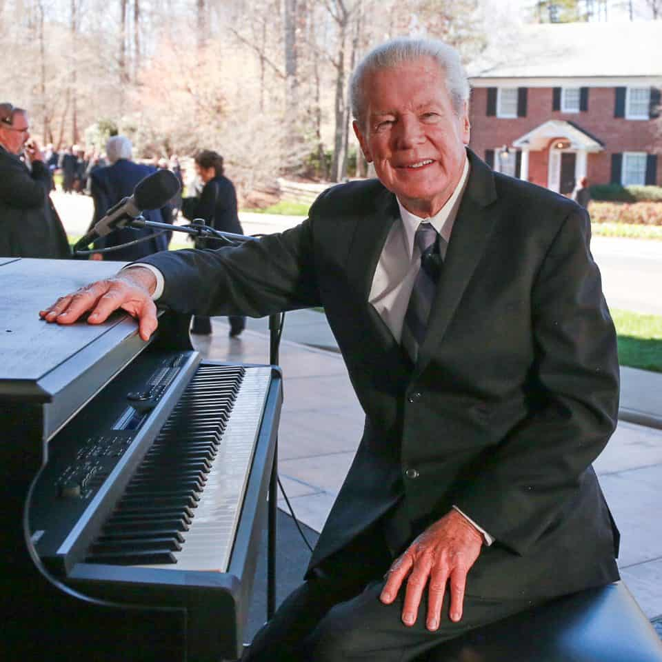 Longtime Crusade pianist John Innes played a medley of worship songs before the funeral.