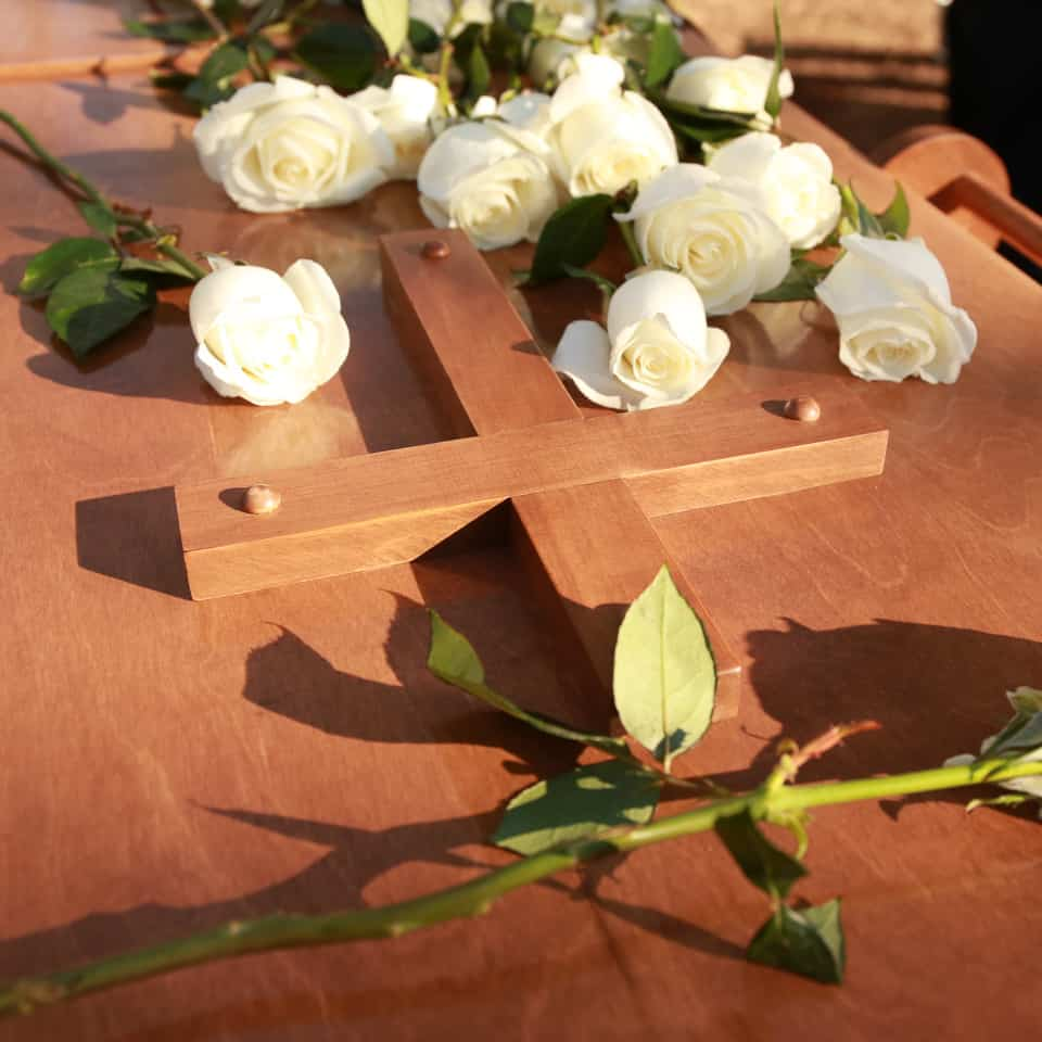 Family members placed white roses on Billy Graham's casket after the private interment ceremony.