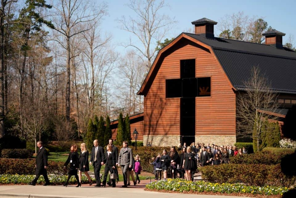Billy Graham's family walks from the Billy Graham Library to the funeral service.