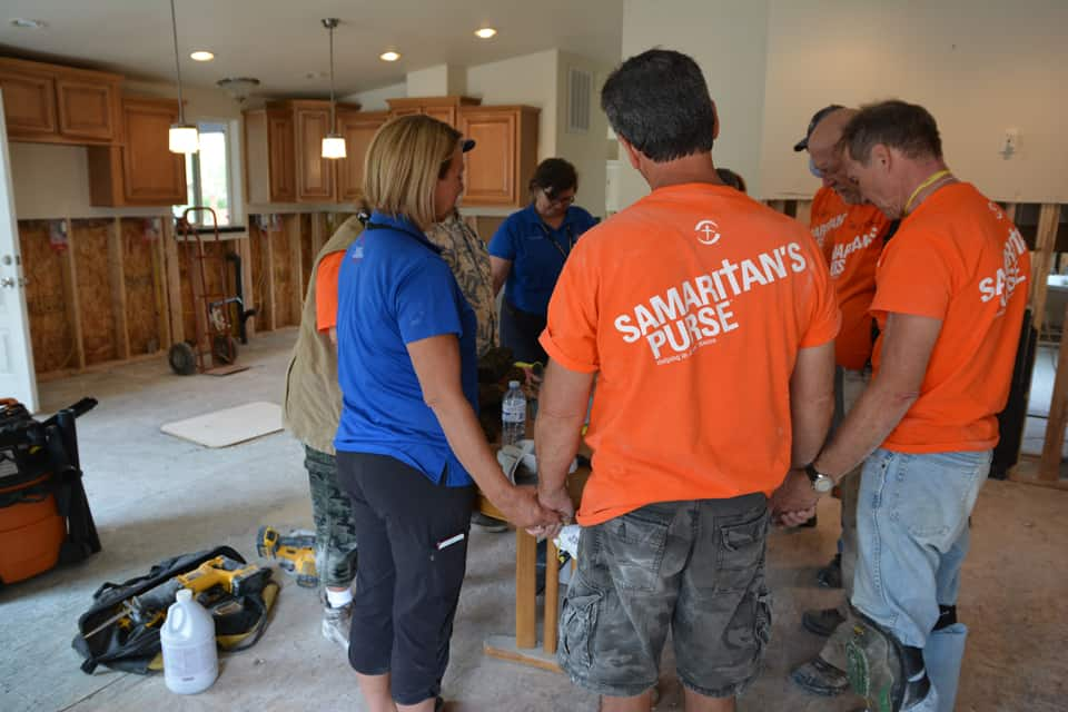 Billy Graham chaplains lead prayer with Samaritan's Purse volunteers at a flooded home in Grand Forks, British Columbia. (BGEA file photo)
