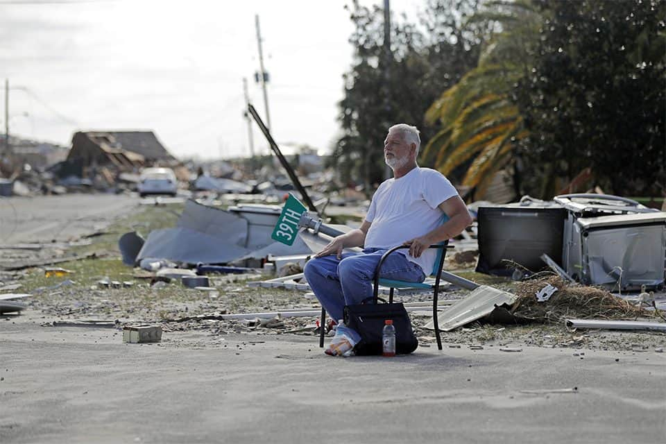 A resident sits among the wreckage in Mexico Beach, Florida, where the hurricane first hit land.