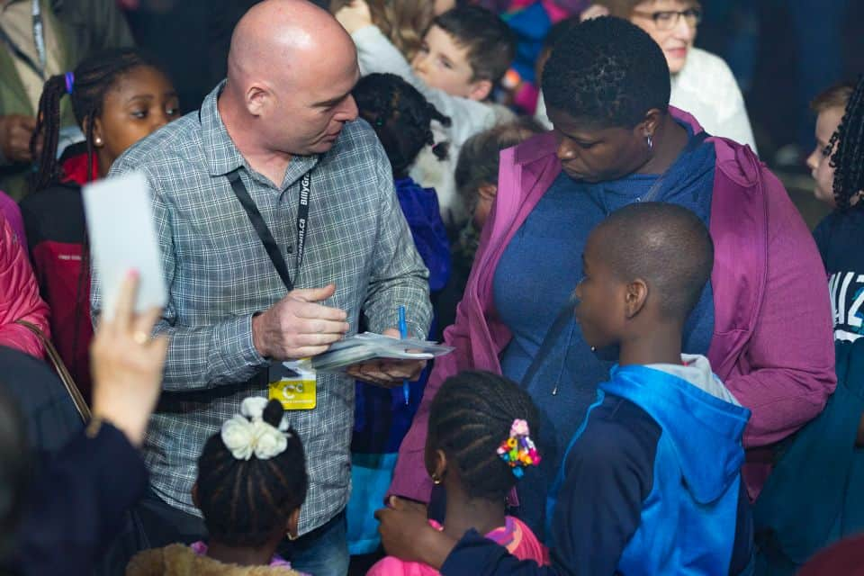 A counselor explains the Gospel to a family who came forward during the invitation to accept Jesus.