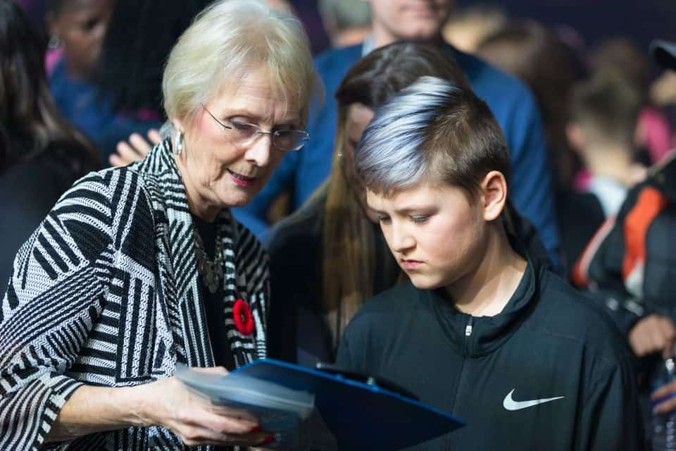 A local adult counselor talks about the Gospel with a student.