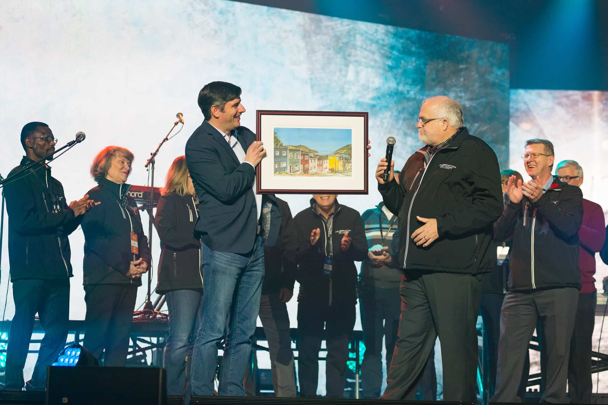 """Thank you for the invitation to come. I love being here."" Lorne Pritchett, the Avalon Celebration's committee co-chair, presented Will Graham with a thank you gift of a painting featuring Jelly Bean Row in St. John's."