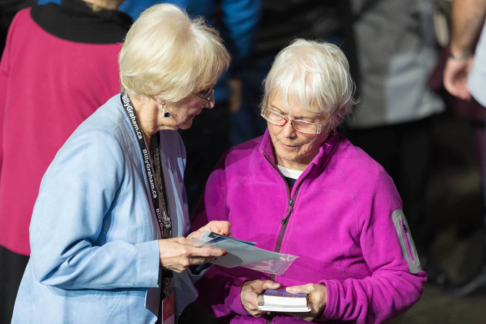 Prayer volunteers play a key role in gathering information from those who walk forward so they can be connected to a local church and receive other resources for growing their faith.