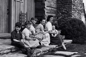 Ruth and her children Gigi, Anne, Ruth, Franklin and Ned sitting on the porch steps.