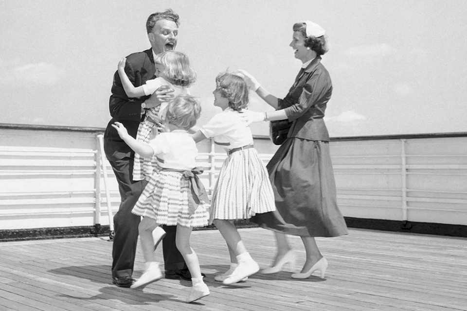 Billy Graham reunites with his daughters and wife after a five-week evangelistic outreach in 1954.
