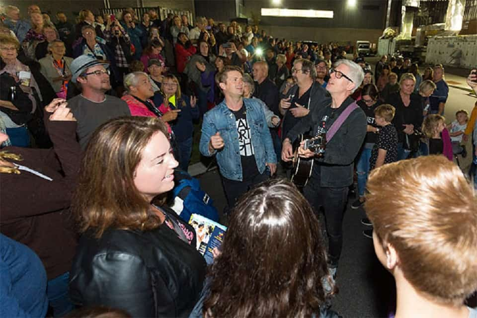 Music artists Josh Havens and Matt Maher make the most of a fire alarm evacuation during the Quinte Celebration of Hope with Will Graham by singing praises in the midst of waiting.