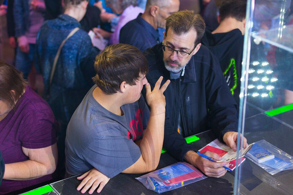 A volunteer counselor (right) shares the Gospel with a young man during the Quinte Celebration of Hope at CAA Arena in Belleville, ON.
