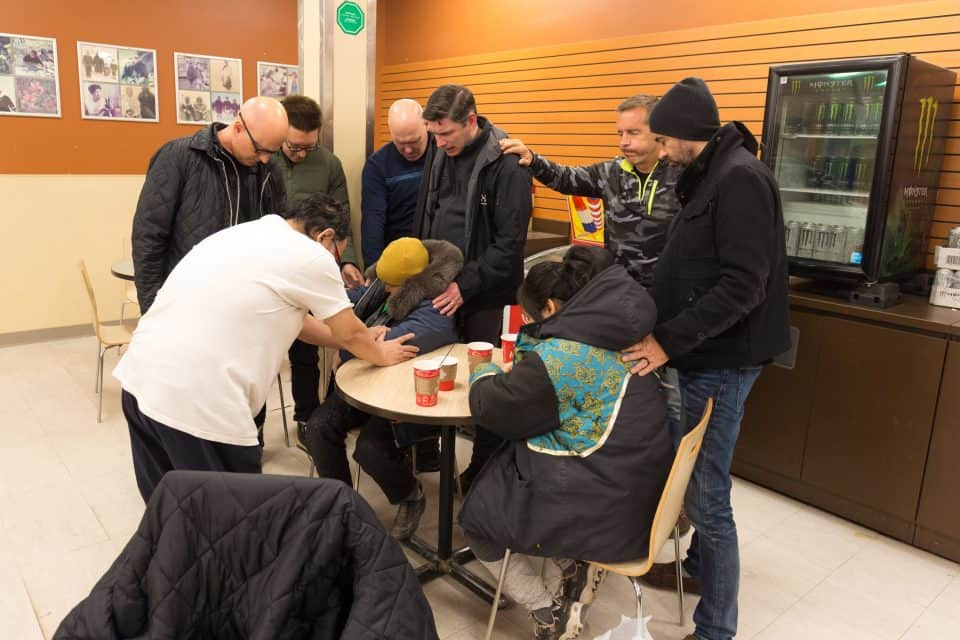 During a stop at Tim Hortons, Will Graham and his team stopped to pray with two residents of Baker Lake.