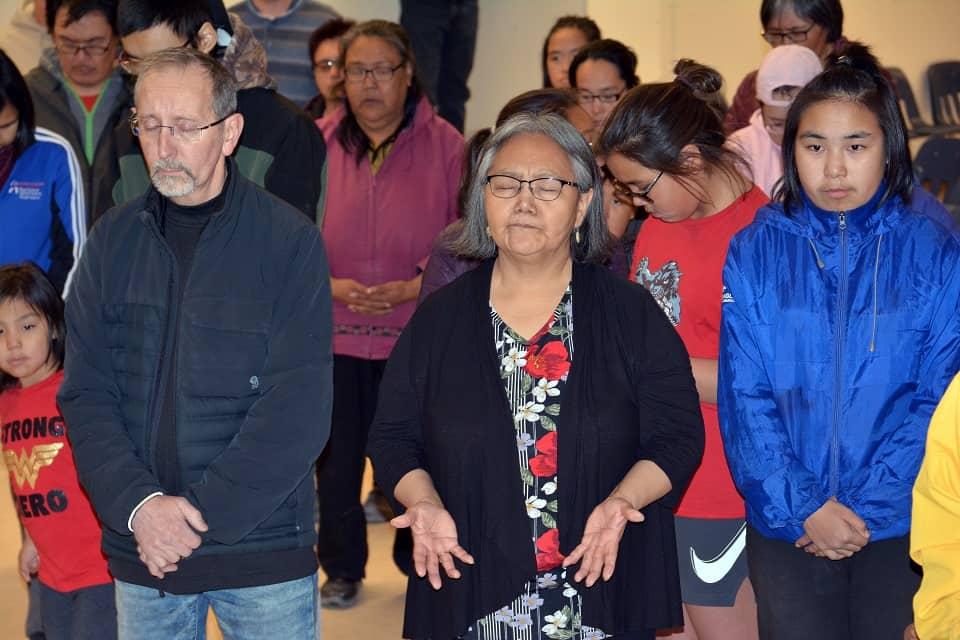 Baker Lake residents pray for revival in their community at Momentum event.