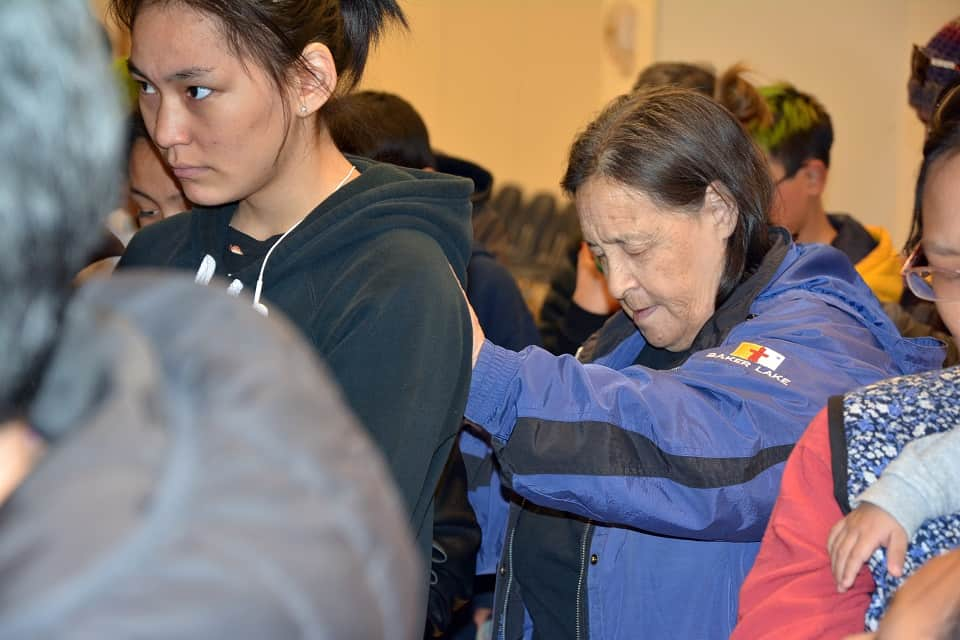 Winnie Tepatai (right) praying for members of her community in Baker Lake to attend the Celebration of Hope with Will Graham. The event is set to take place October 26 and 27 at the Qamanittuaq Recreation Centre.